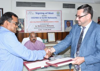 OSDMA managing director Bishnupada Sethi after signing an MoU with a representative of Earth Networks in the presence of Revenue and Disaster Management Minister Maheswar Mohanty in Bhubaneswar, Wednesday