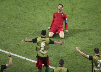 Portugal's Cristiano Ronaldo kneels on the pitch as he celebrates after scoring his side's second goal against  Spain at Fisht Stadium in Sochi Friday