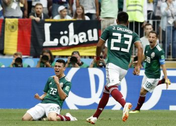 Hirving Lozano (L) celebrates with his teammates after scoring against Germany at the Luzhniki Stadium in Moscow