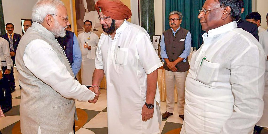 New Delhi: Prime Minister Narendra Modi shakes hands with Punjab CM Amarinder Singh during governing council meeting of NITI Aayog, in New Delhi on Sunday, June 17, 2018. (PTI Photo) (PTI6_17_2018_000062B)