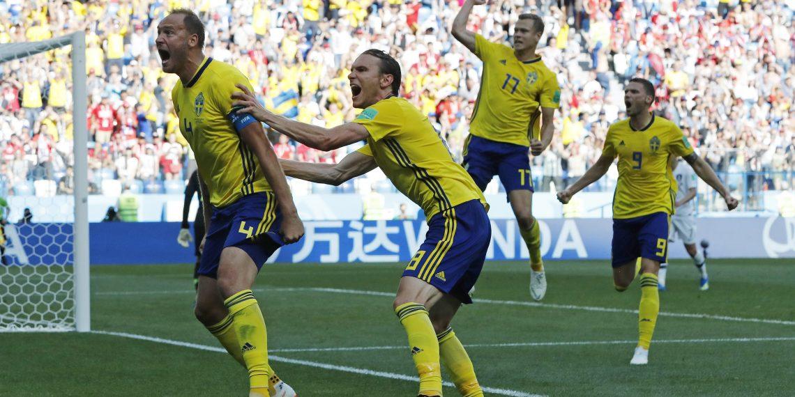 Andreas Granqvist (L) celebrates after scoring the winner against South Korea at the Nizhny Novgorod stadium in Nizhny Novgorod, Russia
