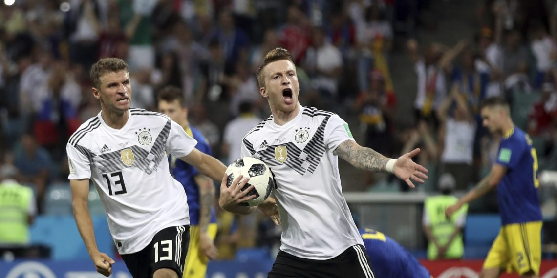 Marco Reus (R) celebrates with Thomas Mueller after scoring Germany's opening goal against Sweden at the Fisht Stadium in Sochi, Russia