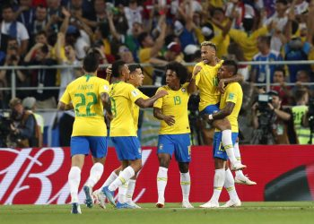 Paulinho (far R) celebrates with teammates after scoring against Serbia at the Spartak Stadium in Moscow