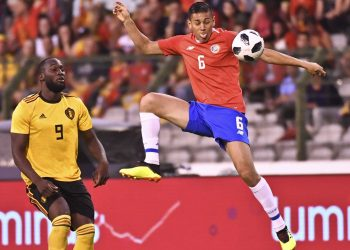 Costa Rica's Oscar Duarte (in red) goes up against Belgium's Romelu Lukaku during their friendly match at the King Baudouin stadium in Brussels