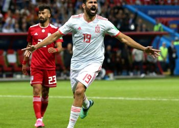 Diego Costa of Spain celebrates his fortuitous goal as hapless Iran defenders rue their luck Wednesday