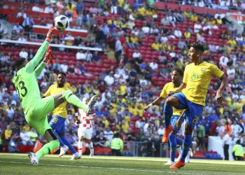 Croatia goalkeeper Danijel Subasic (L) fails to stop a goal by Neymar during their match at Anfield Stadium in Liverpool