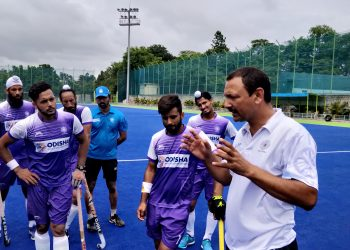 India coach Harendra Singh with the Indian players, Friday