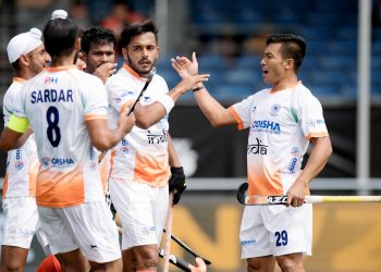 Teammates congratulate Harmanpreet Singh (C) after he scored the first goal for India against Argentina in their Champions Trophy group encounter, Sunday