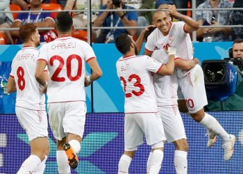 Teammates rush to congratulate Wahbi Khazri (extreme right) after his winning goal against Panama at the Mordovia Arena, Thursday