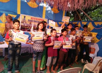 Winners of State Open Rapid Chess Championship pose with their trophies and certificates in Bhubaneswar, Sunday