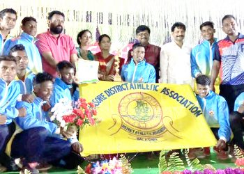 Balasore players pose with their winners' trophies along with officials at Athgarh, Sunday