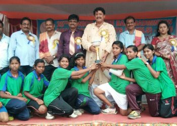 Jagatsinghpur girls pose with their winners' trophy along with guests at Puri, Thursday