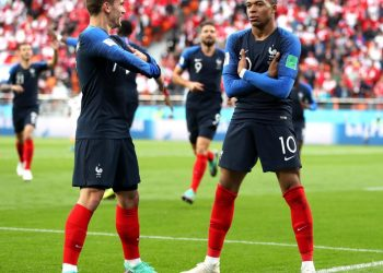 France's Kylian Mbappe (R) does his trademark celebration pose after scoring against Peru at Yekaterinburg, Thursday