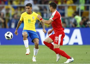 Brazil's Philippe Coutinho (L) controls the ball past Serbia's Dusan Tadic during their group E match at the Spartak Stadium in Moscow, Wednesday