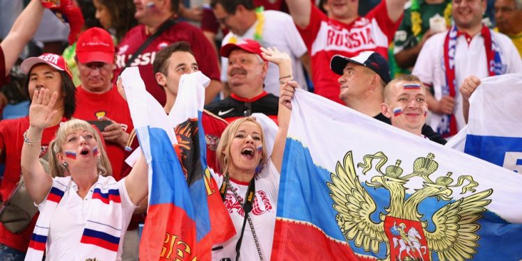 Russian fans celebrate after their win against Saudi Arabia in the World Cup opener in Moscow, Thursday
