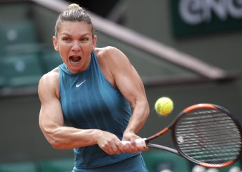 Simona Halep returns the ball to Elise Mertens during their fourth round match of the French Open tennis tournament at the Roland Garros stadium, Monday