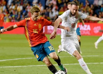 Spain's Nacho Monreal (L) viesfor the ball with Switzerland's Josip Drmic during their international friendly  match. Sunday