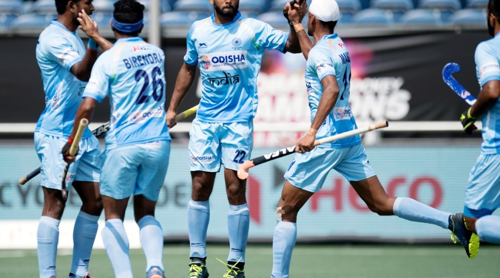 Varun Kumar (2nd right) is congratulated by teammates after scoring India's first goal against Australia, Wednesday