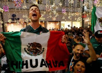Mexican fans celebrate after their team's win against Germany, Sunday