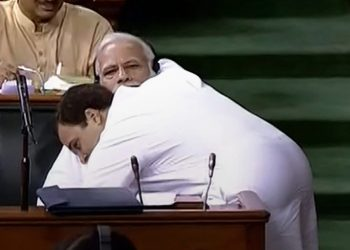 New Delhi: Congress President Rahul Gandhi hugs Prime Minister Narendra Modi after his speech in the Lok Sabha on 'no-confidence motion' during the Monsoon Session of Parliament, in New Delhi on Friday, July 20, 2018. (LSTV GRAB via PTI)(PTI7_20_2018_000081B)