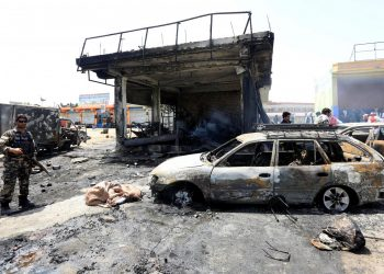 Afghan security forces inspect the site of a suicide attack in Jalalabad city, Afghanistan July 10, 2018. REUTERS/Parwiz