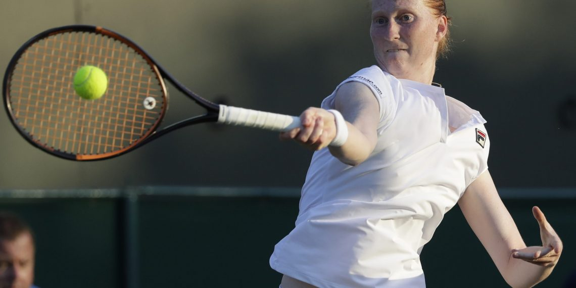 Alison van Uytvanck in action during her stunning victory over Garbine Muguruza, Thursday