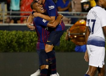 Arthur Melo (R) celebrates with teammate Rafinha after scoring on his maiden appearance for Barcelona against Spurs, Saturday
