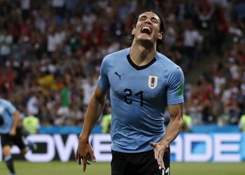 Edinson Cavani celebrates after scoring the opener against Portugal at the Fisht Stadium in Sochi