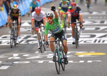 Peter Sagan (in green) celebrates as he crosses that finishing line to win the 13th stage of Tour de France, Friday