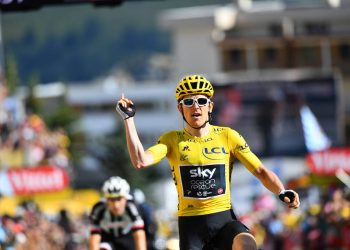 Geriant Thomas celebrates as he crosses the finish line to win the 12th stage of the Tour de France, Friday