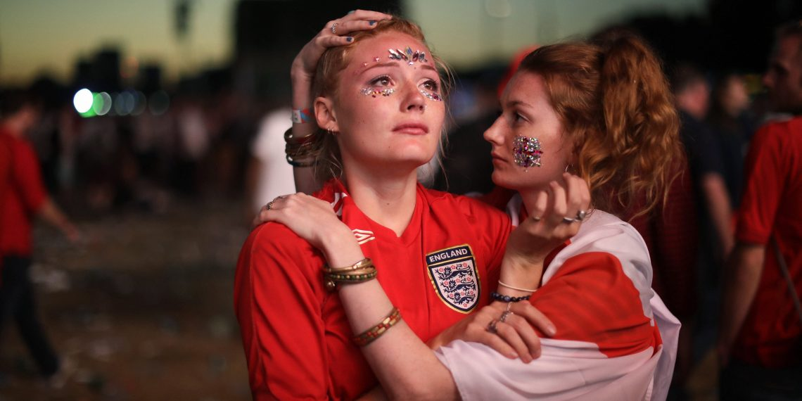 England fans react after their loss against Croatia in the World Cup semifinal in Hyde Park, London, Wednesday