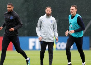 England coach Gareth Southgate (in jacket) looks on during an England training session, Thursday