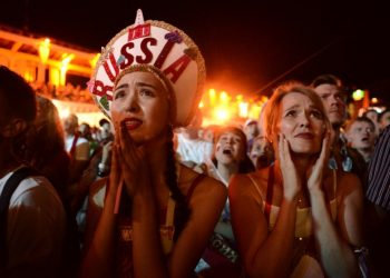 Russian fans react to their team's loss to Croatia at the World Cup quarterfinals, Saturday