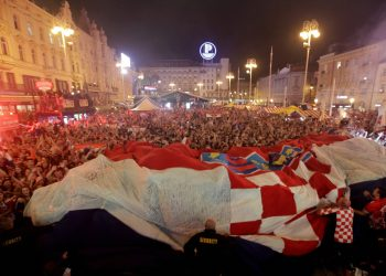 Croatia fans celebrate at the end of the semifinal win over England, in Zagreb, Wednesday