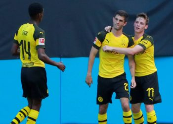 Christian Pulisic (C) is congratulated by his Dortmund teammates after scoring against Liverpool, Sunday