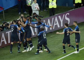 Franch players celebrate Samuel Umtiti's goal against Belgium in the World Cup semifinal at St. Petersburg Stadium, Tuesday
