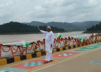 CM Naveen Patnaik waves at people gathered for the opening of Gurupirya bridge