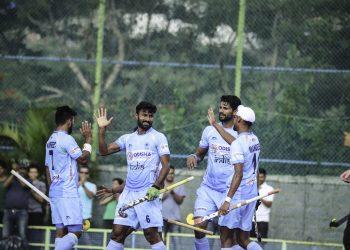 Surender Kumar (C) celebrates with teammates after scoring against New Zealand, Sunday