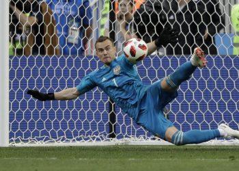 Igor Akinfeev saves the decisive penalty against Spain at the Luzhniki Stadium, Sunday