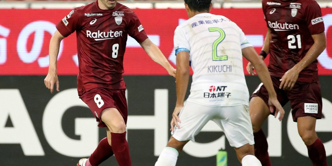 Andres Iniesta (L) in action during his J-League debut with Vissel Kobe
