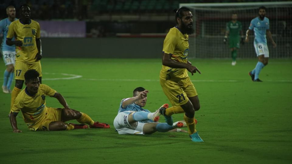 Kerala Blasters FC (in yellow) and Melbourne City FC players in action during their match