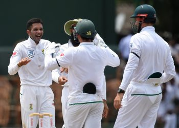 Keshav Maharaj (L) celebrates with South African mates after dismissing a Sri Lankan batsman, Friday