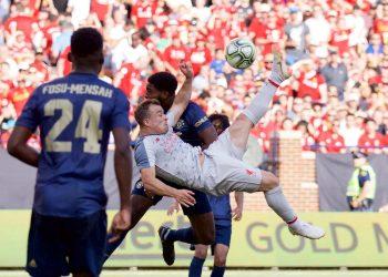 Xherdan Shaqiri (C) scores from an overhead bicycle-kick against Manchester United, Saturday