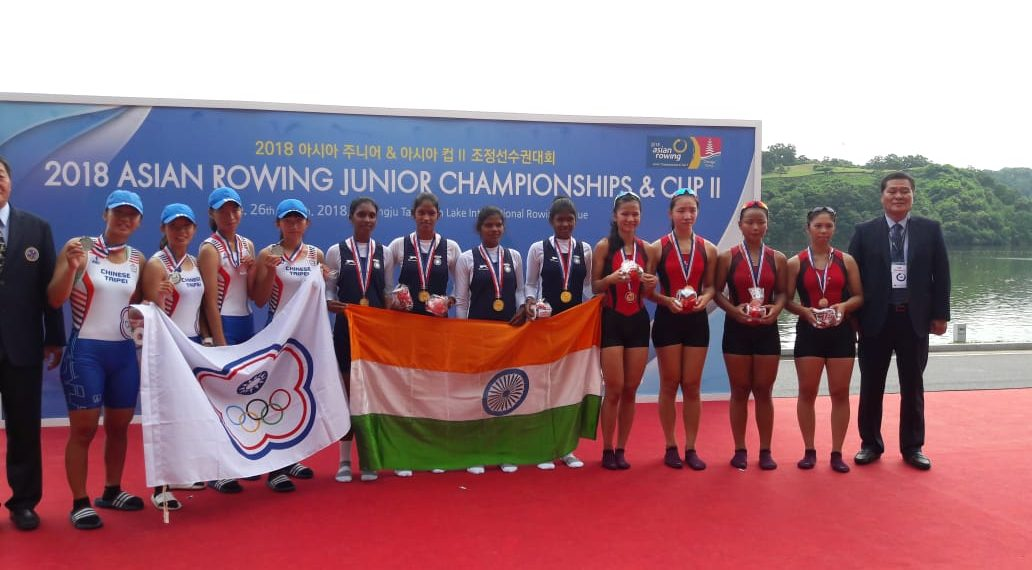 Indian team comprising of four Odisha players (C) pose with the Tricolour and their gold medals at Chungju, Friday