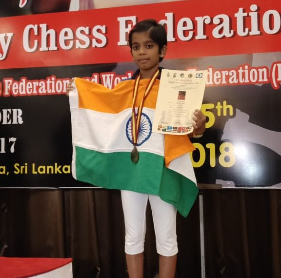 Arushi Srichandan poses with one of her medals and a certificate at Colombo, Saturday