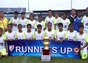 Odisha players pose with the runners-up trophy at Cuttack, Thursday