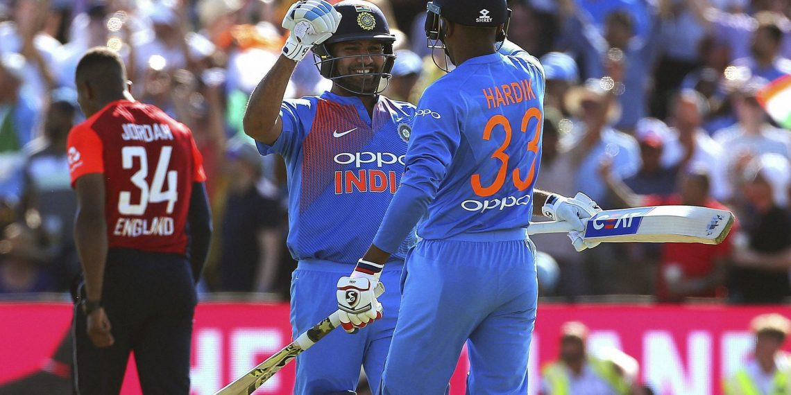 Rohit Sharma and Hardik Pandya celebrate India's victory against England in the final T20 game, Sunday