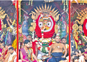 Lord Jagannath (right), Devi Subhadra (middle) and Lord Balabhadra adorned in gold jewellery during Suna Besa in Puri, Monday. OP PHOTO