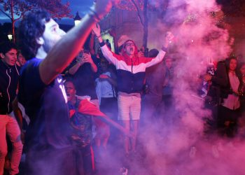 Parisians celebrate after France's win over Belgium in the World Cup semifinals