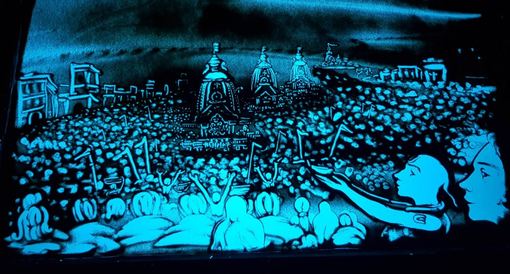A sand animation created by Manas Sahu depicting the car festival of Lord Jagannath in Puri
